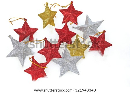 Christmas ornaments: golden,silver,red five-pointed star - stock photo