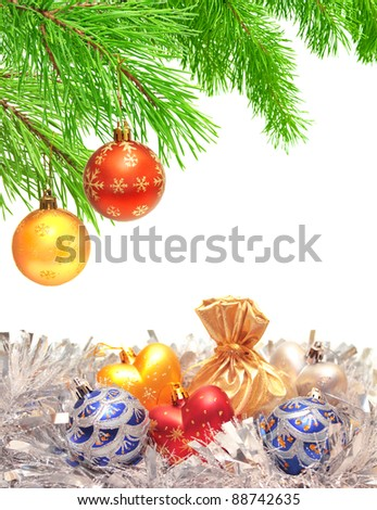 Christmas ornaments on a branch of a pine. Isolated over white - stock photo