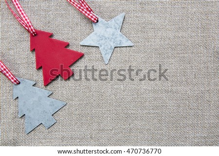 Christmas ornaments on linen background with copy space.