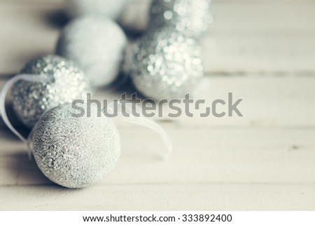 Christmas ornaments on rustic wooden background