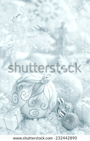 Christmas ornaments on snow - stock photo