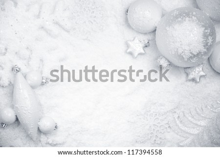 Christmas ornaments on snow,Christmas background. - stock photo