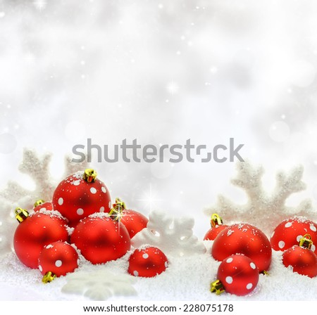 Christmas ornaments on the snow - stock photo