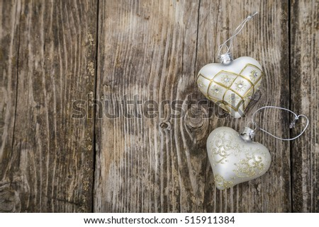 Christmas ornaments on the wooden background. Hearts.