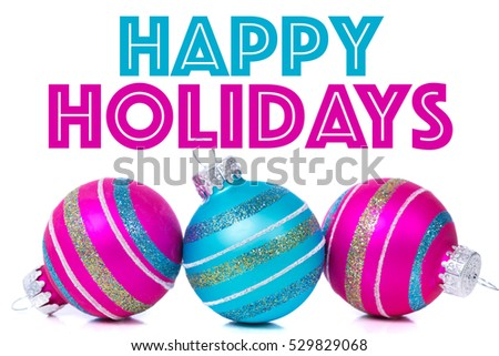 "Christmas ornaments or baubles on white background with ""HAPPY HOLIDAYS"" greeting"