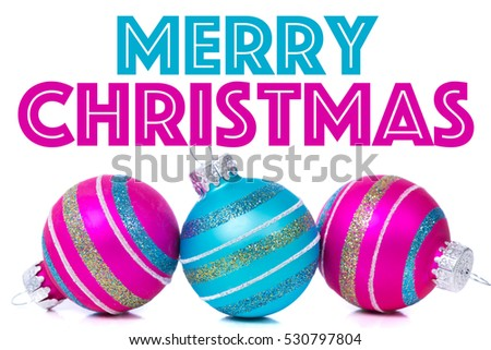 "Christmas ornaments or baubles on white background with white ""Merry Christmas"" greeting"