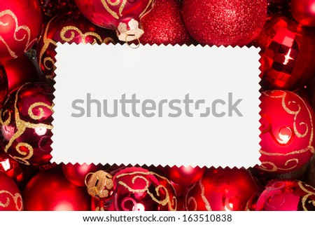 christmas ornaments, red balls and text area on blank xmas card