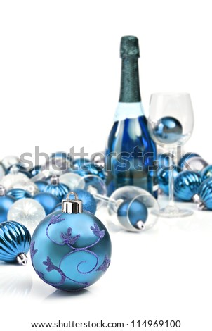 Christmas ornaments with a bottle of sparkling wine