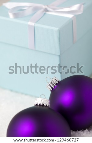 Christmas Ornaments with gift box on snowy background