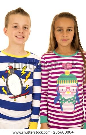 Christmas pajamas portrait of girl and boy - stock photo