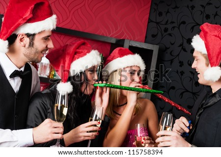 Christmas party cheerful friends at having drink and fun - stock photo