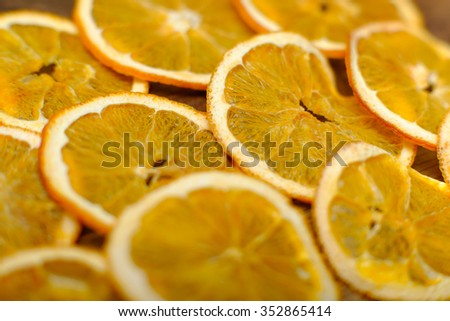 Christmas pattern. Dried oranges on wooden background. Vintage food postcard. - stock photo