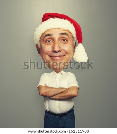 christmas photo of funny bighead man over dark background