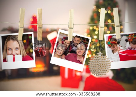 Christmas photos on a line against christmas at home - stock photo