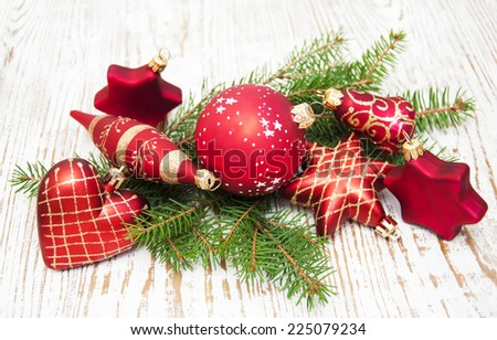 Christmas Pine and Bauble on a wooden background - stock photo