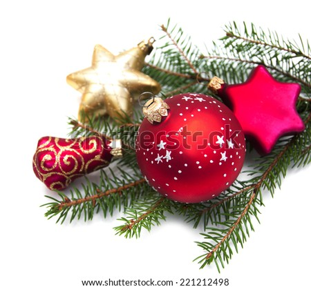 Christmas pine and baubles on a white background - stock photo