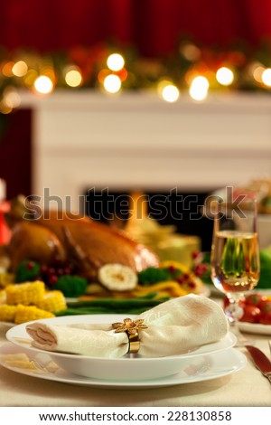 Christmas Place Setting in front of fireplace