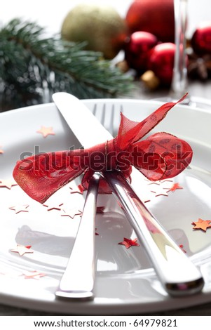 christmas place setting with ribbon - stock photo