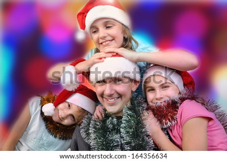 Christmas portrait of happy children against bright background
