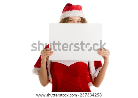 Christmas postcard cute santa girl in xmas costume hides behind blank paper for text