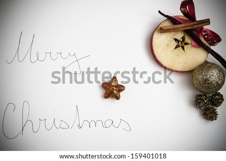 Christmas postcard with apple star, vanilla and cinnamon