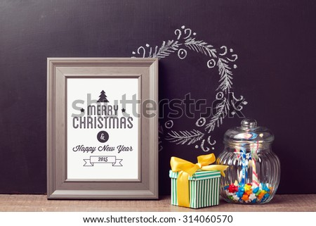 Christmas poster mock up template with candy jar over chalkboard background - stock photo