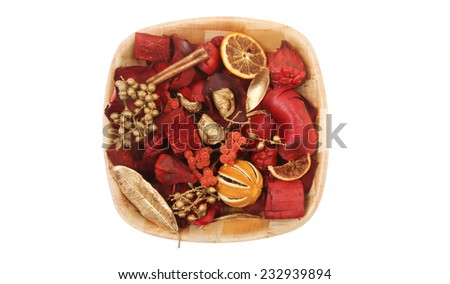 Christmas potpourri in a wooden dish isolated against white - stock photo