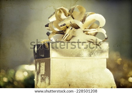 Christmas present box in the snow - vintage photo - stock photo