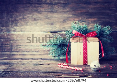 Christmas present on dark wooden background in vintage style  - stock photo