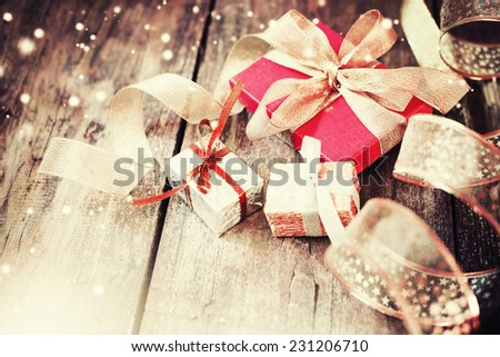 Christmas present  on wooden background in vintage style     - stock photo