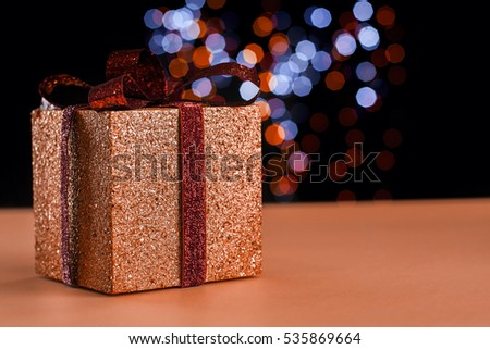 Christmas present with colorful bokeh on a table