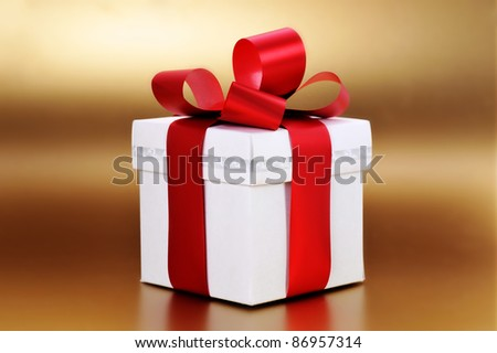 Christmas present with red ribbon close up - stock photo