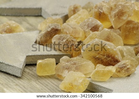 Christmas presentation of candy with stars - stock photo