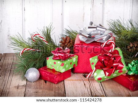 Christmas Presents and Ornaments on Wooden Background With Pine Branches - stock photo