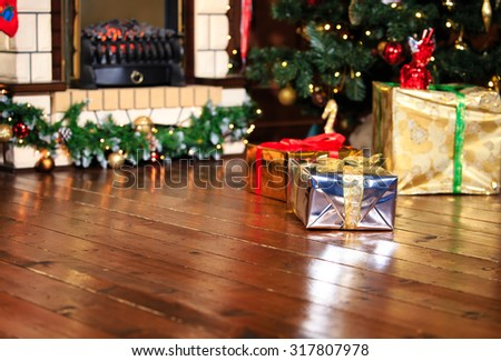 Christmas presents in living room under new year tree, winter holidays - stock photo