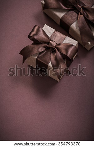 Christmas presents on brown background holidays concept.