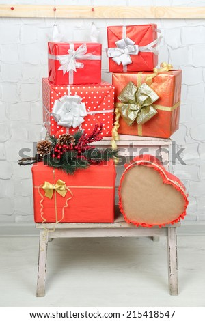 Christmas presents on ladder on brick wall background