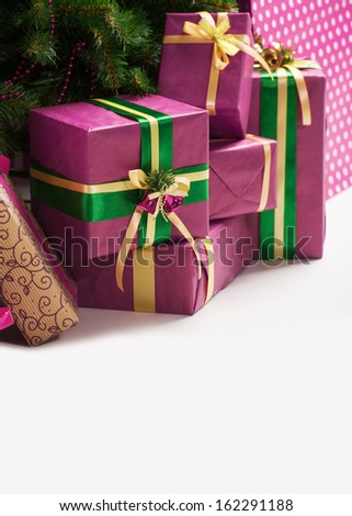 Christmas presents under a holiday tree - stock photo