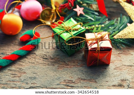 Christmas presents with christmas decorations on wooden background -vintage effect style. - stock photo