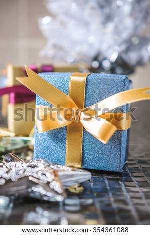 Christmas presents with gold ribbon on white background