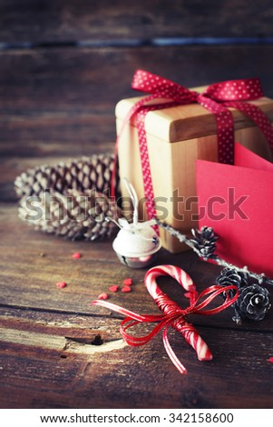 Christmas presents with red ribbon on dark wooden background in vintage style  / selective focus