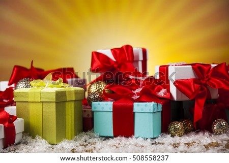 Christmas presents with red ribbon on wooden background
