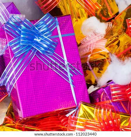 Christmas Presents wrapped in colorful paper and ribbon