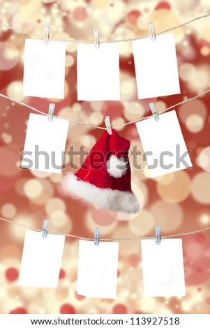 Christmas pricing tags and santa's hat hanging on the rope with christmas defocused light background - stock photo