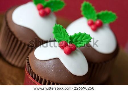 Christmas pudding cupcakes - stock photo