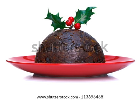 Christmas pudding with holly on top against a white background. - stock photo
