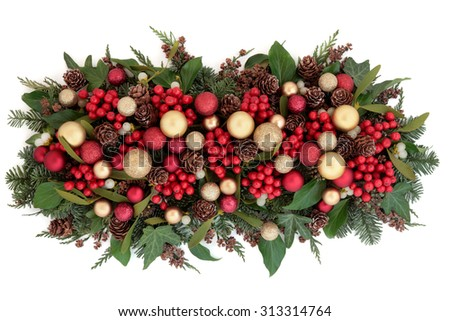 Christmas red and gold bauble decorations, holly, mistletoe, ivy, pine cones and traditional greenery over white background. - stock photo