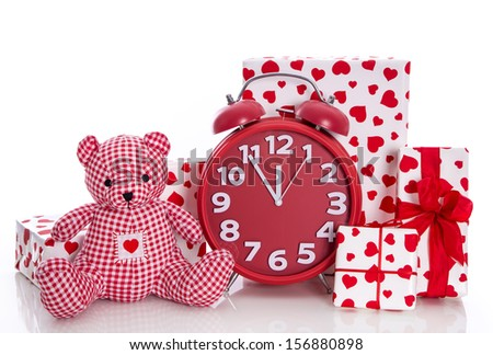 Christmas: red and white presents with clock and  pink teddy bear on white background - last minute shopping - stock photo
