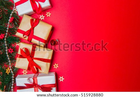 Christmas red background view with tree, gift and decoration
