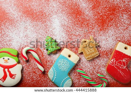 christmas red background with snow and cookies, holiday food